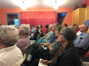 WEPA and community members listening intently to speakers at the meeting.